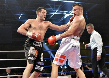 Carl Froch (L) of Britain punches Mikkel Kessler of Denmark during their super-middle weight title bout in Herning April 24, 2010. REUTERS/Scanpix/Henning Bagger