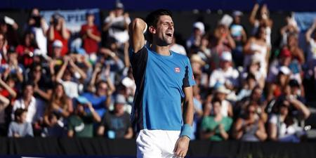 Serbia's Novak Djokovic laughs during his exhibition doubles tennis match with Spain's Rafael Nadal against Argentina's David Nalbandian and compatriot Juan Monaco in Buenos Aires November 23, 2013. REUTERS/Marcos Brindicci