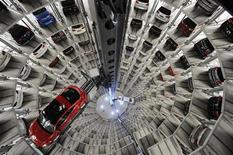 """A Volkswagen """"Beetle"""" (L) and an """"UP!"""" are pictured in a delivery tower at the company's headquarter in Wolfsburg, March 12, 2012. REUTERS/Fabian Bimmer"""