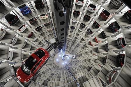 A Volkswagen ''Beetle'' (L) and an ''UP!'' are pictured in a delivery tower at the company's headquarter in Wolfsburg, March 12, 2012. REUTERS/Fabian Bimmer