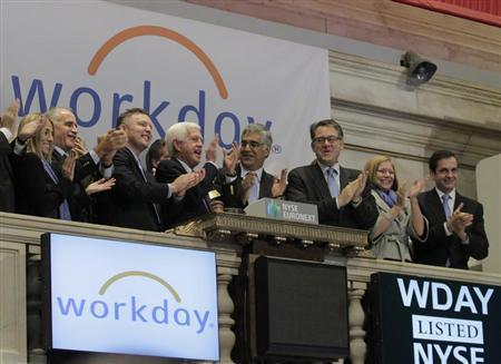 Workday Inc. Chairman, Co-Founder and Co-CEO Aneel Bhusri (center R) and Co-Founder and Co-CEO Dave Duffield (center L) ring the opening bell with company executives in celebration of the company's IPO at the New York Stock Exchange, October 12, 2012. REUTERS/Brendan McDermid