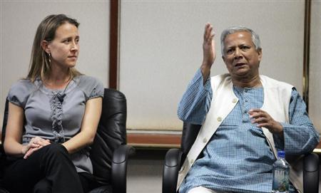 Panelists Anne Wojcicki, co-founder of 23and Me Inc. and 2006 Nobel Peace Prize Laureate Muhammad Yunus (R), managing director, Grameen Bank from Bangladesh take part in the Revolutionizing Health Care and Research in the Developing World panel at the Global Overview panel at 2008 Milken Institute Global Conference in Beverly Hills California April 28, 2008. REUTERS/Fred Prouser