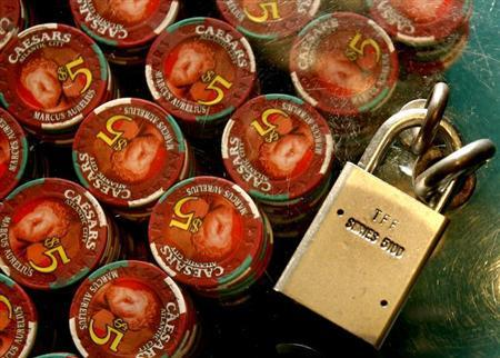 Roulette chips are locked down at Caesars in Atlantic City, New Jersey July 5, 2006. REUTERS/Tim Shaffer