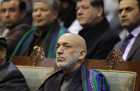 Afghan President Hamid Karzai attends the last day of the Loya Jirga, in Kabul November 24, 2013. REUTERS/Omar Sobhani