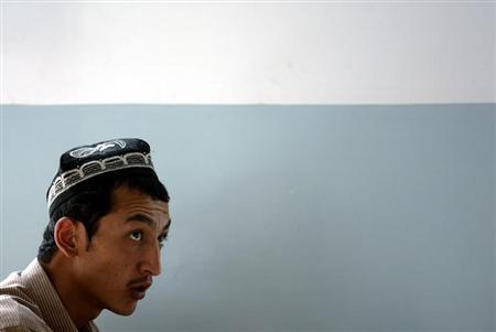 A Uighur student attends a lesson at the Xinjiang College of Uighur Medicine in Hotan in the southwestern part of China's Xinjiang Uighur Autonomous Region September 15, 2003. REUTERS/Andrew Wong