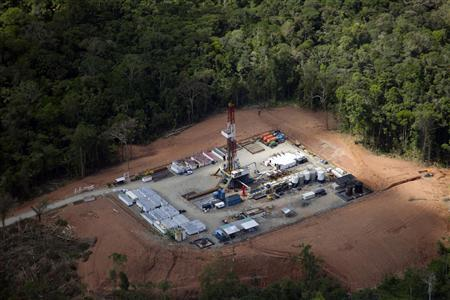 An exploration rig is seen in this aerial overview taken at the Cuyabeno reserve in Lago Agrio in the Sucumbios Province in this October 1, 2013 file photo. REUTERS/Guillermo Granja/Files