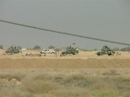 EDITOR'S NOTE: Reuters is unable to independently verify the authenticity of the photo. Iraqi security forces are seen outside Camp Ashraf in Diyala province, north of Baghdad, in this April 8, 2011 handout photo provided by Camp Ashraf. REUTERS/Camp Ashraf/Handout
