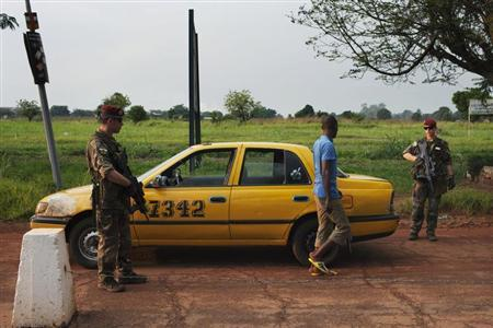 French soldiers inspect a taxi at a checkpoint at the Mpoko airport in Bangui November 23, 2013. REUTERS/Joe Penney