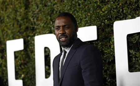 Cast member Idris Elba poses at the premiere of ''Mandela: Long Walk to Freedom'' in Los Angeles, California November 11, 2013. REUTERS/Mario Anzuoni
