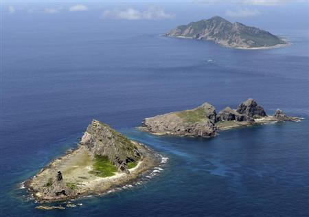 A group of disputed islands, Uotsuri island (top), Minamikojima (bottom) and Kitakojima, known as Senkaku in Japan and Diaoyu in China is seen in the East China Sea, in this photo taken by Kyodo September 2012. REUTERS/Kyodo/Files