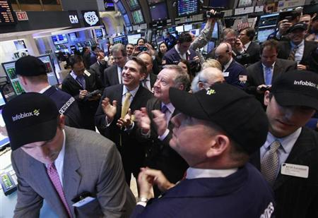 Infoblox Inc. executives Stuart Bailey (centre, L), founder and chief technology officer, and Robert Thomas, president and CEO, celebrate their company's IPO on the floor of the New York Stock Exchange April 20, 2012. REUTERS/Brendan McDermid