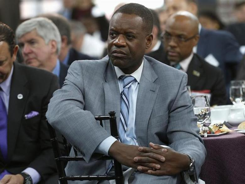 Detroit Emergency Manager Kevyn Orr listens to a panel discussion following a news conference announcing a $20 million partnership to bring Goldman Sachs' 10,000 Small Businesses initiative to the city of Detroit, Michigan November 26, 2013. REUTERS/Rebecca Cook