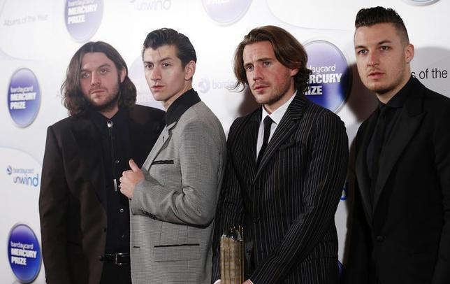 Musicians (L-R) Nick O'Malley, Alex Turner, Jamie Cook and Matt Helders from the Arctic Monkeys, nominees for the Mercury Music Prize, pose for a photograph ahead of the ceremony in north London, October 30, 2013. REUTERS/Olivia Harris