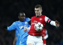 Arsenal's Jack Wilshere (R) challenges Olympique Marseille's Giannelli Imbula during their Champions League soccer match at the Emirates stadium in London November 26, 2013. REUTERS/Eddie Keogh
