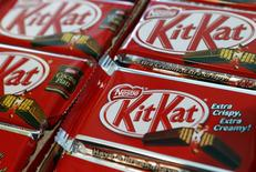 A Nestle logo is pictured on KitKat chocolate bars, during the nine month sale figures news conference at the company headquarters in Vevey in this October 17, 2013 file photo. REUTERS/Denis Balibouse/Files