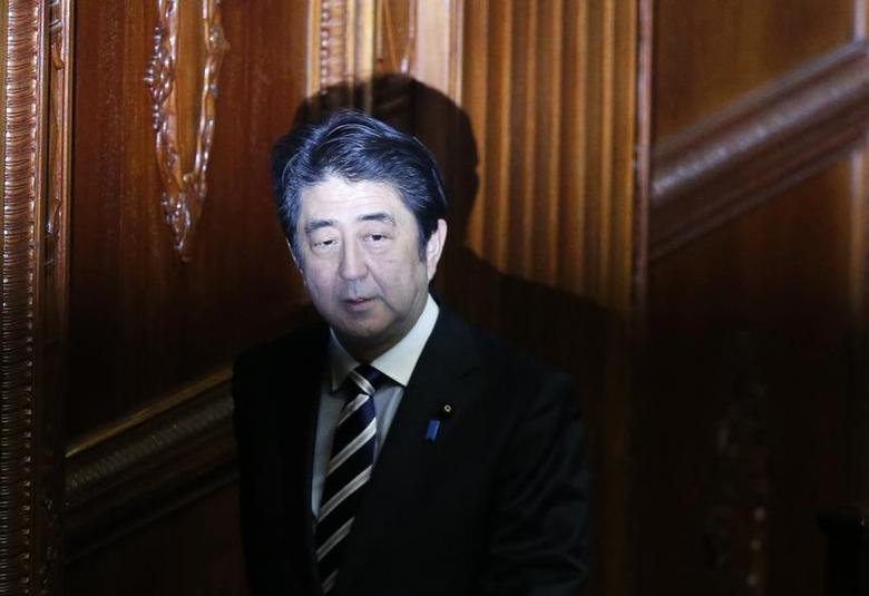 Japan's Prime Minister Shinzo Abe arrives the Lower House plenary session at the parliament in Tokyo November 26, 2013. REUTERS/Toru Hanai