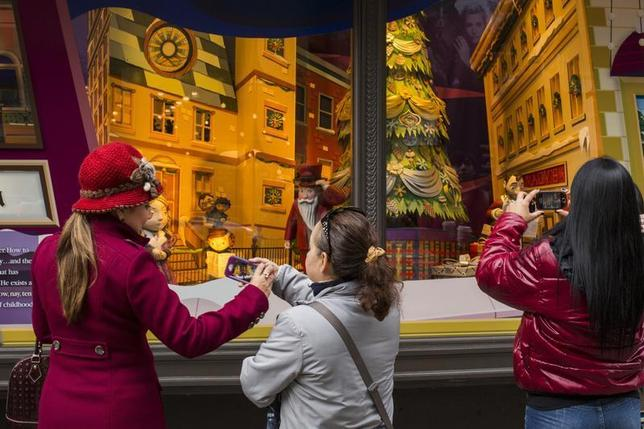 Pedestrians stop to look at holiday window displays at Macy's flagship store in New York, November 22, 2013. REUTERS/Lucas Jackson