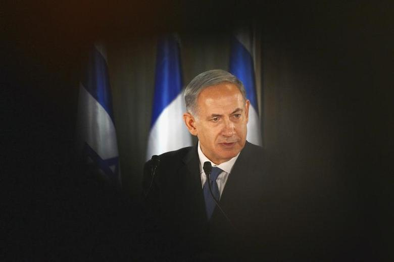Israel Prime Minister Benjamin Netanyahu speaks during a joint news conference with French President Francois Hollande (not pictured) at his residence in Jerusalem November 17, 2013. REUTERS/Alain Jocard/Pool