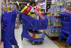 A woman shops at a Toy R Us store in Carle Place, New York in this November 23, 2012 file photo. REUTERS/Shannon Stapleton/Files