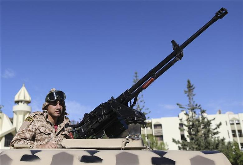 A member of the Libyan army guards the streets following yesterday's clashes in Benghazi November 26, 2013. REUTERS/Esam Omran Al-Fetori
