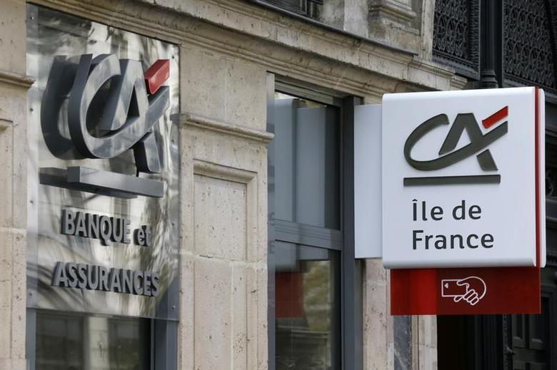 Logos are seen on a Credit Agricole branch in Paris, November 7, 2013. REUTERS/ Jacky Naegelen