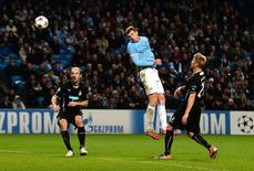 Manchester City's Edin Dzeko (2nd R) heads to score to score during their Champions League soccer match against Viktoria Plzen at the Etihad Stadium in Manchester, northern England, November 27, 2013. REUTERS/Nigel Roddis