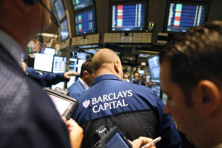 Traders gather at the Barclays Capital's kiosk on the floor of the New York Stock Exchange April 7, 2010. REUTERS/Brendan McDermid