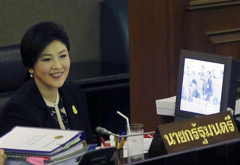 Thailand's Prime Minister Yingluck Shinawatra smiles during a debate by the opposition in parliament in Bangkok November 26, 2013. REUTERS/Chaiwat Subprasom