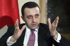 Премьер-министр Грузии Ираклий Гарибашвили дает интервью агентству Рейтер в Тбилиси 26 ноября 2013 года. Грузия не боится давления России и через пять лет после войны с ней готова проигнорировать интересы своего северного соседа, парафировав соглашение о сближении с Евросоюзом. REUTERS/Georgy Kakulia