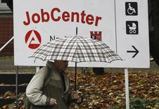 A man walks in front of a job centre in Berlin, October 30, 2008. REUTERS/Fabrizio Bensch
