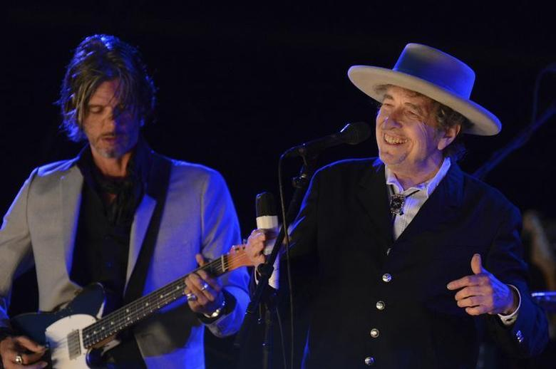 Musician Bob Dylan (R) performs on the second day of the Hop Farm Music Festival in Paddock Wood, Kent June 30, 2012. REUTERS/ Ki Price