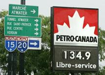 A gasoline station in Montreal advertises the price of regular gas at C$1.34.9 ($1.14) a litre, August 31, 2005. REUTERS/Shaun Best