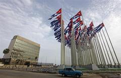 A car drives past the building of the the U.S. diplomatic mission in Cuba, The U.S. Interests Section, (USINT), in Havana, in this September 12, 2013 file picture. REUTERS/Desmond Boylan/Files