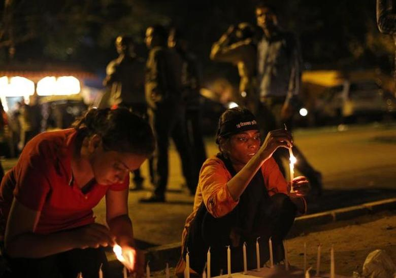 Demonstrators light candles during a candle light vigil after four men convicted of raping and murdering a 23-year-old woman in Delhi were sentenced to death in New Delhi September 13, 2013. REUTERS/Mansi Thapliyal/Files