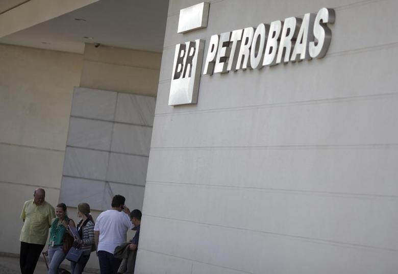 People walk in front of the Petrobras University building in Rio de Janeiro October 9, 2012. REUTERS/Ricardo Moraes