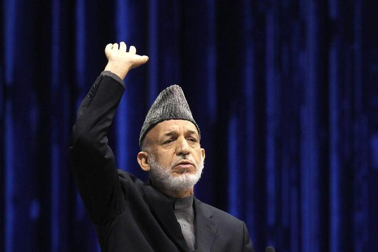 Afghan President Hamid Karzai speaks during the last day of the Loya Jirga, in Kabul November 24, 2013. REUTERS/Omar Sobhani