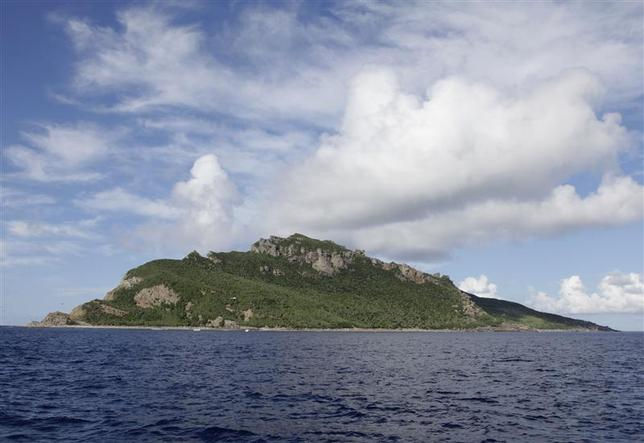 A group of disputed islands known as Senkaku in Japan and Diaoyu in China is seen from the city government of Tokyo's survey vessel in the East China Sea in this September 2, 2012 file photo. Picture taken September 2, 2012. REUTERS/Chris Meyers/Files