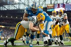 Detroit Lions defensive tackle Ndamukong Suh (90) sacks Green Bay Packers quarterback Matt Flynn (10) in the end zone for a safety during the third quarter during a NFL football game on Thanksgiving at Ford Field. Mandatory Credit: Tim Fuller-USA TODAY Sports