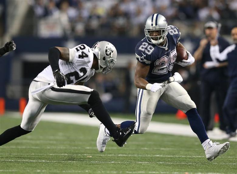 Nov 28, 2013; Arlington, TX, USA; Dallas Cowboys running back DeMarco Murray (29) runs with the ball in the fourth quarter against Oakland Raiders cornerback Charles Woodson (24) during a NFL football game on Thanksgiving at AT&T Stadium. The Cowboys beat the Raiders 31-24. Mandatory Credit: Matthew Emmons-USA TODAY Sports
