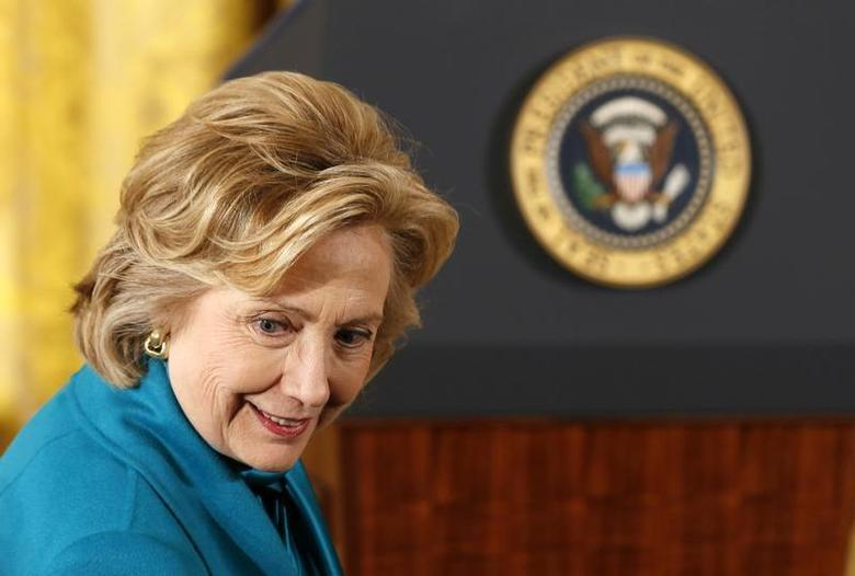 Former first lady Hillary Clinton sits down before the Presidential Medal of Freedom ceremony in the East Room of the White House in Washington, November 20, 2013. REUTERS/Larry Downing