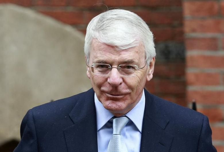 Former British Prime Minister John Major arrives to give evidence to the Leveson Inquiry into the ethics and practices of the media, at the High Court in London June 12, 2012. REUTERS/Olivia Harris