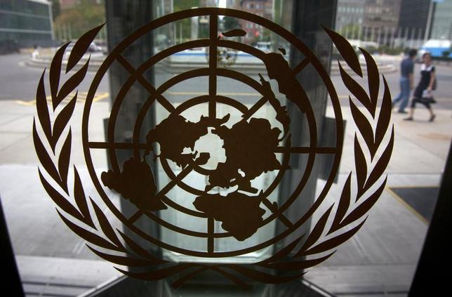 The United Nations logo is seen on one of the front doors at the U.N. Headquarters in New York, August 31, 2013. REUTERS/Carlo Allegri