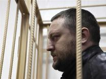 Yury Zarutsky looks out from the defendant's holding cell during a court hearing in Moscow in this March 7, 2013 file photo. REUTERS/Maxim Shemetov/Files