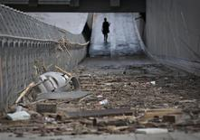 Debris left from flood waters litters a downtown sidewalk in Calgary, Alberta June 24, 2013. REUTERS/Andy Clark