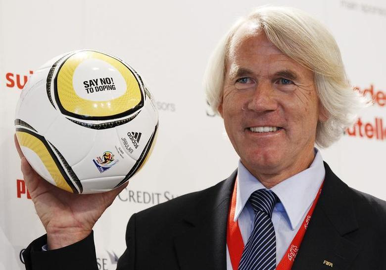 Jiri Dvorak, Chief Medical Officer of the FIFA poses for photographers as he presents a ball with the lettering ''SAY NO! TO DOPING'' during a news conference at the training camp of Switzerland's national soccer team in Crans Montana May 29, 2010. REUTERS/Michael Buholzer