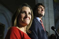 Liberal leader Justin Trudeau takes part in a news conference with Chrystia Freeland (L), the recently nominated Liberal candidate for the upcoming federal by-election in the riding of Toronto Centre, on Parliament Hill in Ottawa in this file photo from September 17, 2013. REUTERS/Chris Wattie/Files
