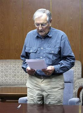 U.S. citizen Merrill E. Newman reads from a piece of paper at an undisclosed location in this undated photo released by North Korea's Korean Central News Agency (KCNA) in Pyongyang on November 30, 2013. North Korea said on Saturday it had arrested Newman for 'hostile acts' against the state and accused him of being 'a criminal' who was involved in the killing of civilians during the 1950-53 Korean War. REUTERS-KCNA