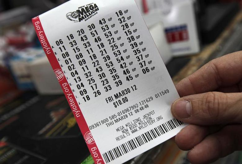 A man holds his Mega Millions lottery ticket at a shop on New York City's upper west side of Manhattan March 29, 2012. REUTERS/Mike Segar