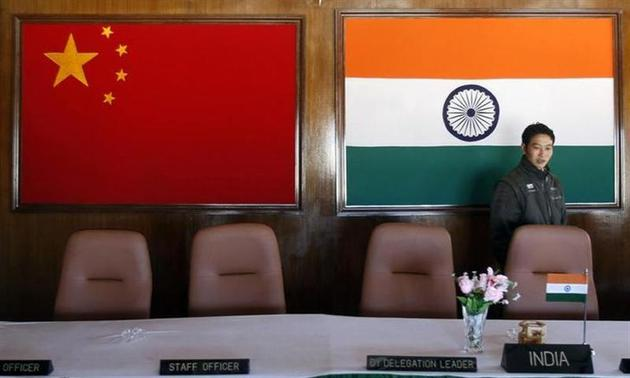 A man walks inside a conference room used for meetings between military commanders of China and India, at the Indian side of the Indo-China border at Bumla, Arunachal Pradesh, November 11, 2009. REUTERS/Adnan Abidi/Files