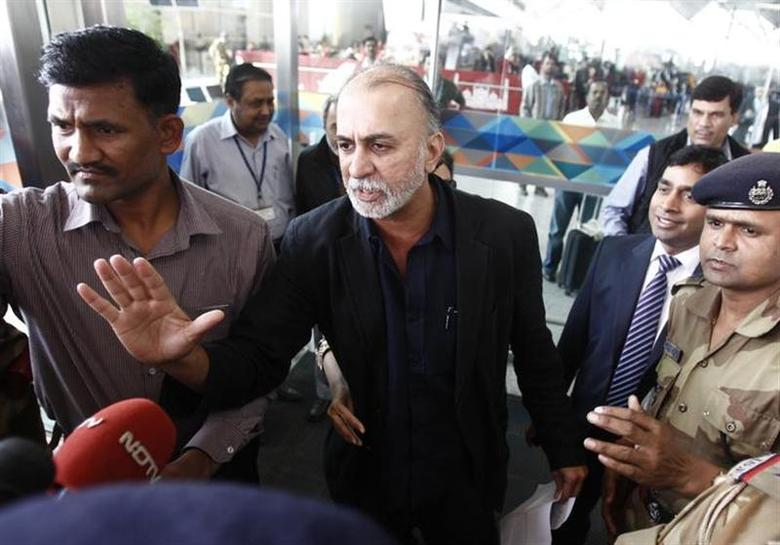 Tarun Tejpal, the 50-year-old founder and editor-in-chief of India's leading investigative magazine Tehelka, speaks with the media upon his arrival at the airport on his way to Goa, in New Delhi November 29, 2013. REUTERS/Anindito Mukherjee